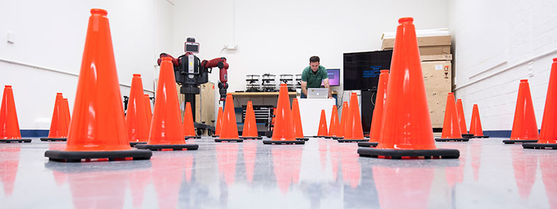 A student building a robot obstacle course