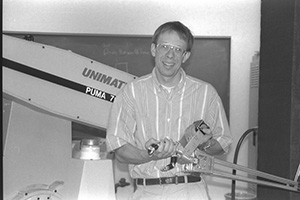 Randal Nelson with PUMA robot and MIT hand.