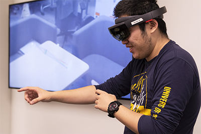 Sifan Ye '20 tests an Augmented Reality field in Prof. Bai's AR/VR Lab